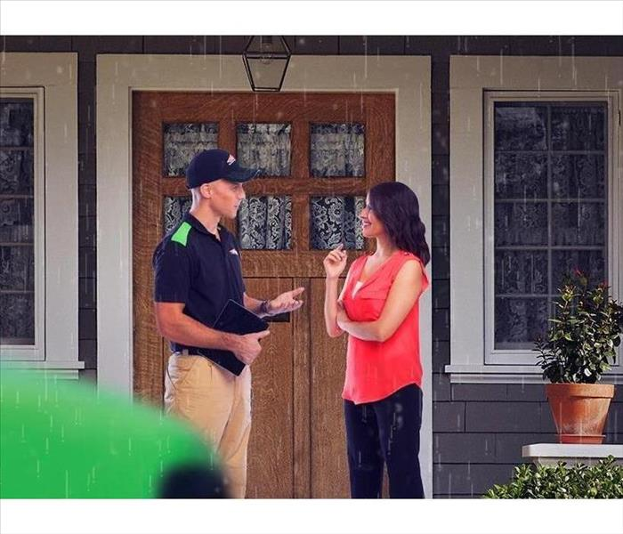 SERVPRO technician talking to a customer
